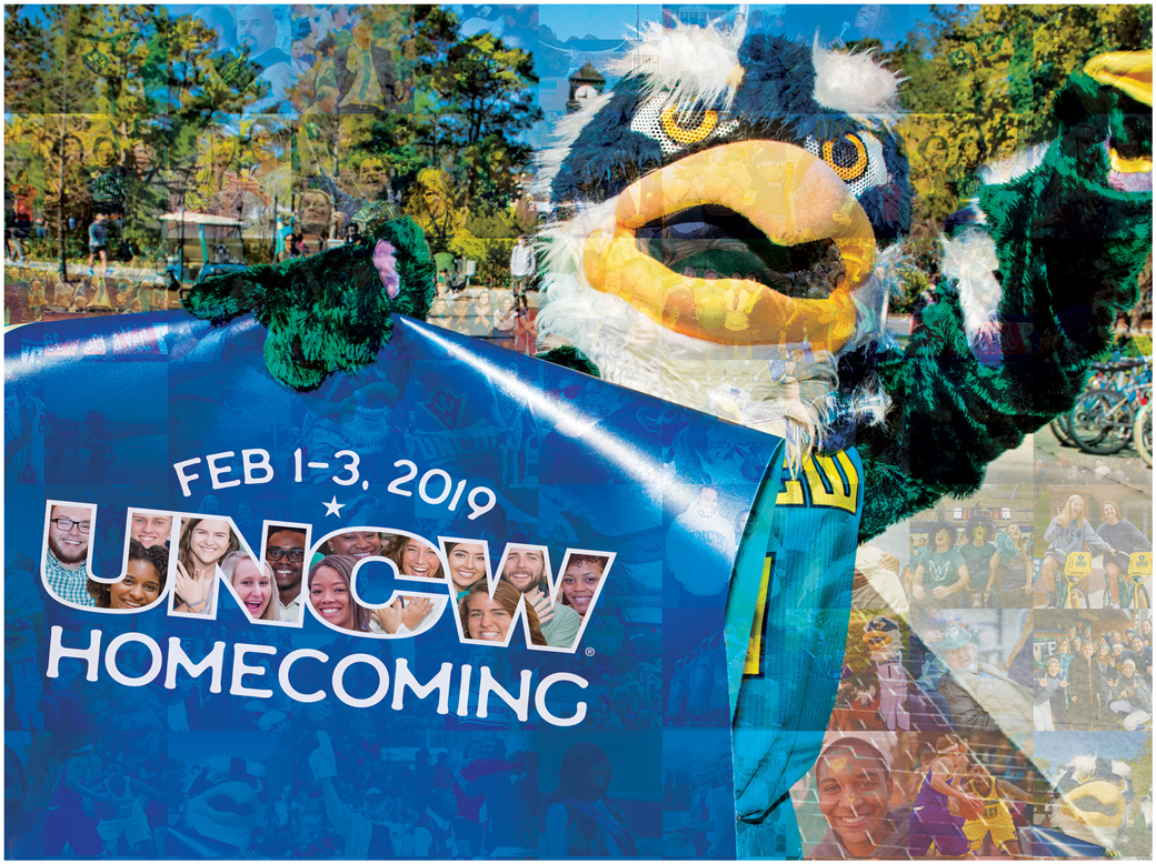 Sammy holding sign: Feb 1-3, 2019 UNCW Homecoming