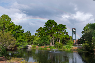 Luetze Lakes and Clock Tower with rainbows in the sky